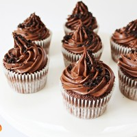 Oreo Stuffed Chocolate Cupcakes with Dark Chocolate Ganache Frosting