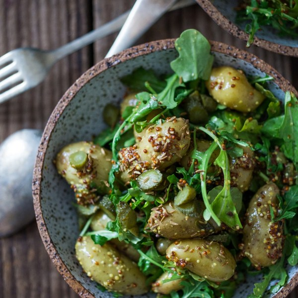 Warm potato salad with mustard seed dressing, cornichons and caraway